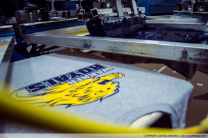Warner Royals logo being printed on a screen-printing press.